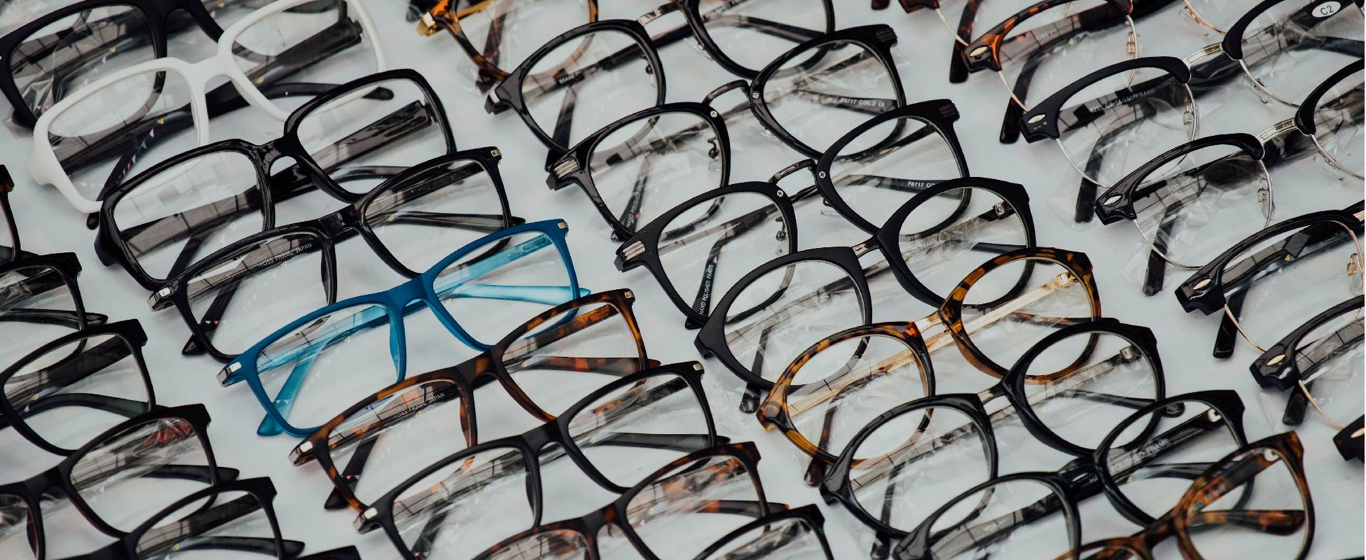Eyeglass frames stacked neatly